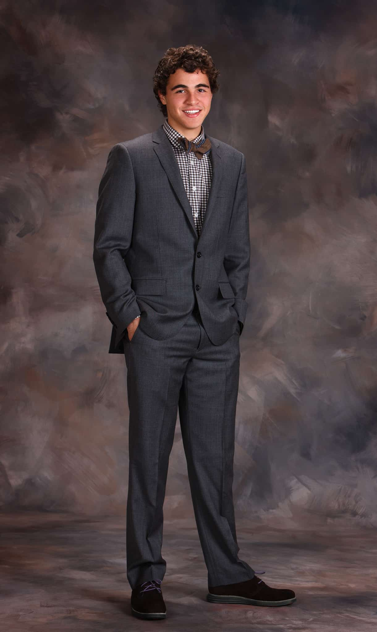 High_school_senior_photographed_in_suit