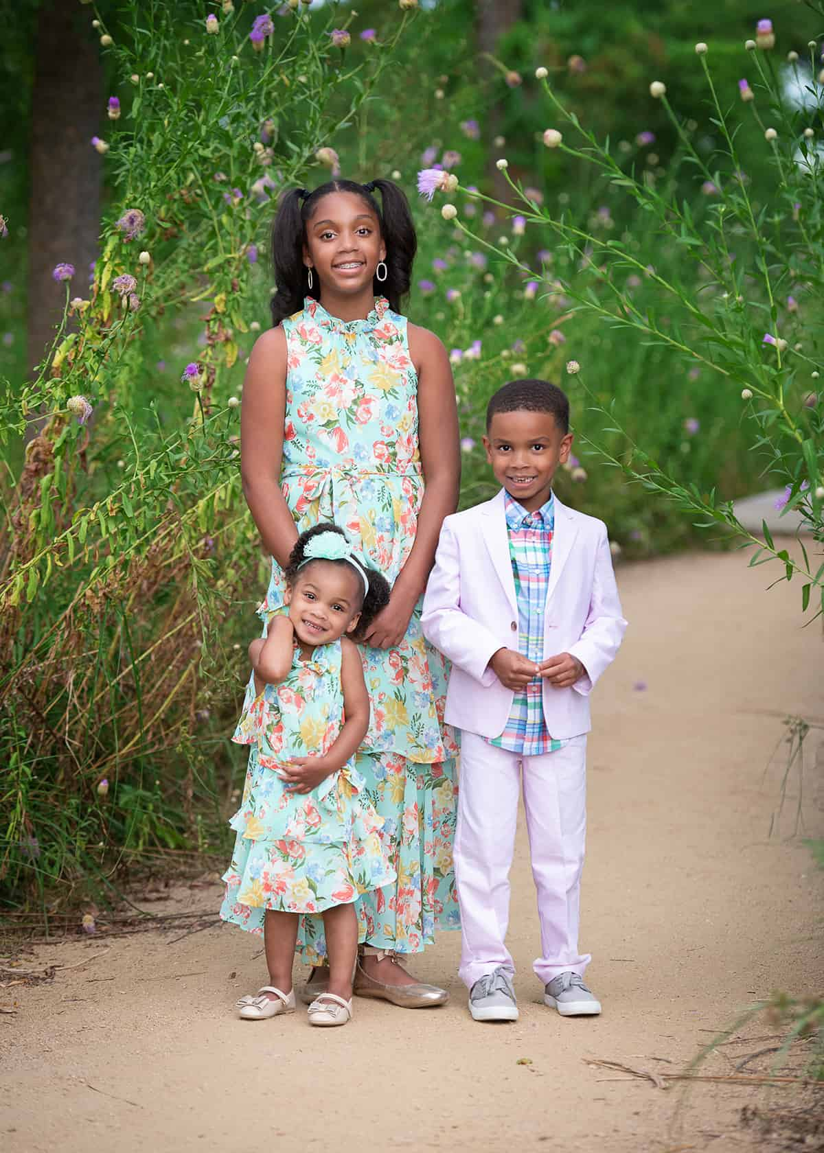 Children in the spring at the Houston Arboretum for photoshoot
