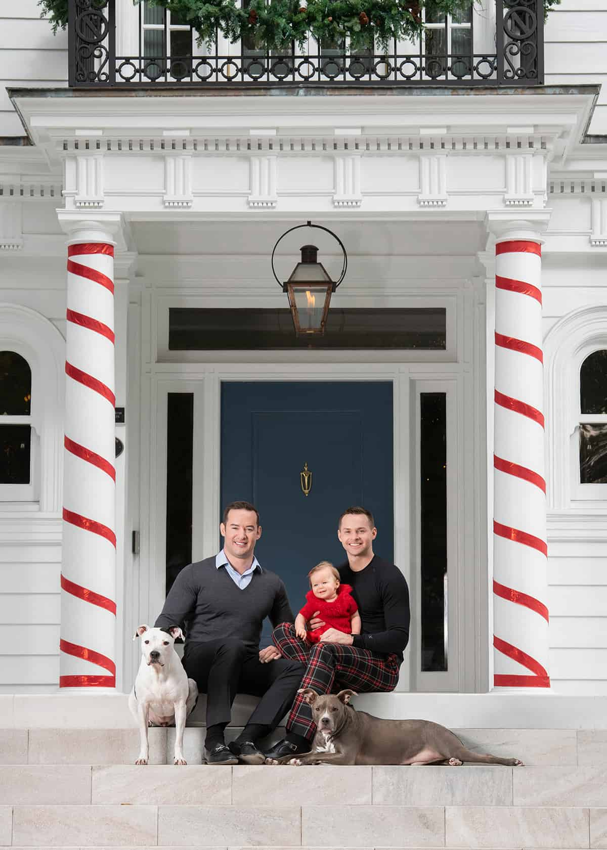 Young family with baby and two dogs for holiday photoshoot